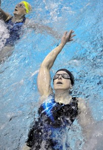 Patty Moran concentrates on her form while performing the backstroke during an Alaska Masters Swim Club session.