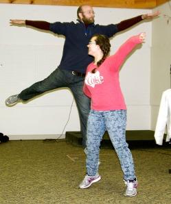 Austin Terrell performs a scene with Sabrina Ferguson, an eighth-grader at Ninilchik School, at an improv workshop held Saturday in Ninilchik.