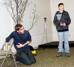 Royce Roeswood (left) improvs a scene with Robert McGinnis, in the eighth grade at Ninilchik School, during a Ninilchik workshop Saturday.