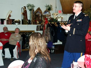 Photos by Jenny Neyman, Redoubt Reporter. Col. James Halliday leads attendees in the Pledge of Allegiance at a Valentine's Day dinner for veterans held by Tom and Adele Bearup.
