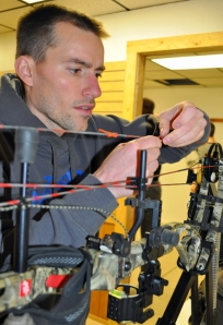 Brian Richards, owner of Wilderness Way, works on a bow for one of the league members.