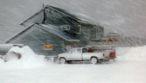 Wind whips snow around a building in Dillingham.