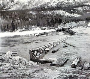 Photo courtesy of Mona Painter. Kenai Lake is completely open water at the failed Kenai River bridge following the quake.