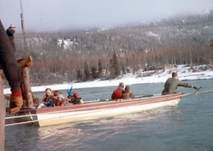 Photo courtesy of Mona Painter. Jack Coppock rigged his boat as a ferry to transport people across Kenai Lake following the destruction of the bridge in the Good Friday quake. Here he hauls kids to school following the quake.