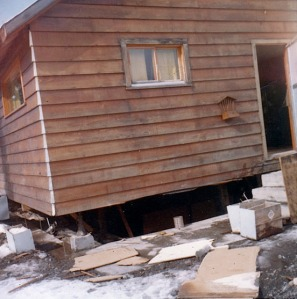 Photo courtesy of Mona Painter. The Mlynarik home on the shore of Kenai Lake in Cooper Landing was knocked off its foundation during the quake.