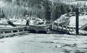 Photo courtesy of Alaska Department of Transportation. ADOT workers begin remediation of the Cooper Landing bridge collapse following the 1964 quake.