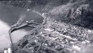 Photo courtesy of Kenai Peninsula College Photo Archive. This aerial photo of Seward before the 1964 earthquake shows the docking facilities that would be destroyed in the quake.