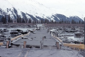 Photo courtesy of Kenai Peninsula College Photo Archive. The 1964 Good Friday earthquake destroyed this bridge over Twenty Mile Creek on the Seward Highway along Turnagain Arm.
