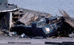 Photo courtesy of Kenai Peninsula College Photo Archive. An Alaska Railroad engine is crushed in the wreckage along the waterfront in Seward.
