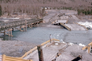 The Kenai River bridge at Kenai Lake in Cooper Landing is in ruins after the Photo courtesy of Kenai Peninsula Photo Archive. Good Friday earthquake, which struck Southcentral Alaska on March 27, 1964. A temporary Bailey Bridge was installed shortly after the quake, while cleanup and reconstruction of the bridge took place.