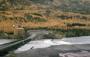 Photo courtesy of Kenai Peninsula Photo Archive. The Bailey Bridge over the Kenai River at Kenai Lake in the fall of 1964.