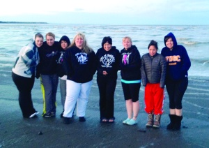 Photos courtesy of Central Peninsula Relay for Life. Relay for Life volunteers steel themselves before a chilly plunge into Cook Inlet on Saturday. From left is Johna Beech, Melyssa Nordwall, Chastity Peterson, Stacey Day, Carmen Triana, Hadassah Udelhoven and Joy Petrie.