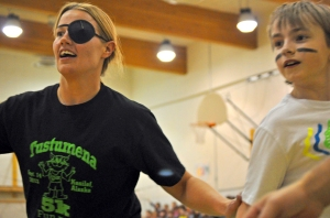 Teacher Cynthia Fudzinski is hindered by an eye patch in trying to cover student Jack Harris.