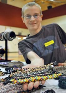 Photos by Joseph Robertia, Redoubt Reporter. Maguire Merriman, 13, diagnosed with autism roughly six years ago, displays some of the bracelets and key chains he made and was selling during the Walk for Autism held Saturday in Soldotna.