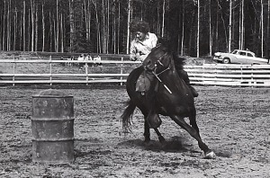 Abby Ala practices barrel racing on Hope in 1961.