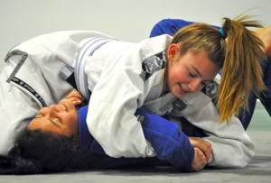 Photo by Joseph Robertia, Redoubt Reporter. During a sparring session at Redemption MMA in Soldotna, Morgan Nelson tries to get Stephanie Sanez to submit to a jujutsu hold.