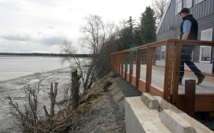 Hyde took an experimental strategy for stabilizing the bluff above the Kenai River — concrete mats held together with stainless steel webbing, filled with gravel, covered in dirt and planted with natural vegetation.