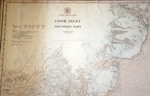 An on Cook Inlet nautical chart was found behind a wall during demolition and now is restored and displayed in the remodeled administration building.