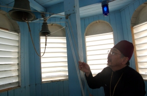 Fr. Thomas Andrew prepares to ring the bells at Holy Assumption of the Virgin Mary Russian Orthodox Church on Thursday to commemorate the quake.