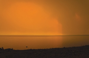 Photo by Joe Kashi. Smoke from the Funny River Horse Trail Fire creates an eerie scene at Skilak Lake on Monday.