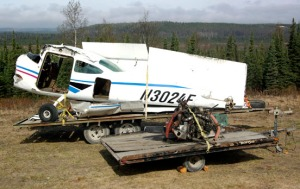 Photos by Jenny Neyman. Donny Joachim's Cessna 172 sits in pieces at his home on Funny River Road this week, after crash landing at the foot of Skilak Glacier on April 29.