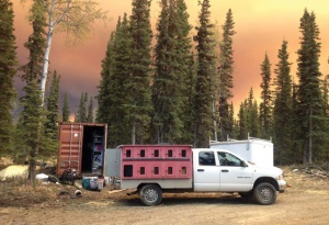 Photo courtesy of Jill Garnet. Jill Garnet readies her dog truck in preparation of evacuating her home and kennel in Kasilof, as the Funny River Horse Trail Fire draws near last week. Residents with livestock or lots of animals faced a particular challenge in getting ready to get out of the path of the fire.