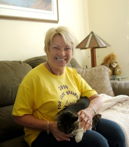 Photo by Jenny Neyman, Redoubt Reporter. Phyllis Swarner snuggles with her cat, Mutto, in her home in Kenai. She will be one of many volunteers and survivors at the Central Peninsula Relay for Life on Friday and Saturday at the Kenai Central High School track.