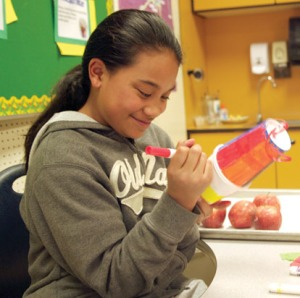 Redoubt fifth-grader Destiny Salmona colors away on her pinata-in-the-making.