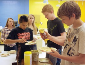 Soldotna Middle School students (from left) Mikala Mudrick, Sean McMullen, Delaney Risley, Sam Snow and Kyle Bauter, make tortillas in Spanish class at the end of the school year. Part of the students' experience in Spanish class is to help teach the language to elementary kids.