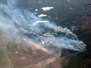 Photo courtesy of the Alaska Division of Forestry. Fire nears the village of Tyonek on Tuesday.
