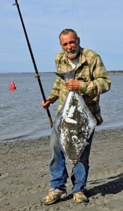Galen Neptune, of Kasilof, pulled this 20-pound halibut from the water.