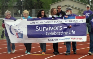 Photos courtesy of Central Peninsula Relay for Life. Cancer survivors battle the wind while walking in the Survivors Lap to kick off the 2014 Central Peninsula Relay for Life on May 30 in Kenai.