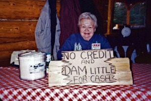 In later years, Helen Gwin enjoyed serving as cashier at fundraising functions. Jack Lean had a sign in his store (which later became the Cooper Landing Post Office, and now is a museum building) that Gwin got a kick out of, so she had a sign made with the same wording.
