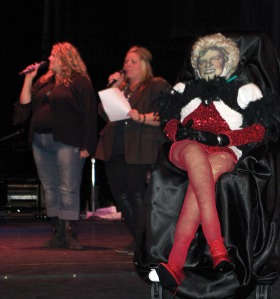 "KCHS alumni Mary McCubbins-Holt and Lisa McCubbins-Thompson perform ""Black Velvet"" at the Pops Concert this year in the shadow of Edit D. Smith, bearing Henderson's likeness and her signature red high-heeled shoes, which was jokingly announced as Henderson's replacement during the Pops Concert this year."