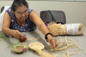 Rose Guilbeau, of Kenai, displays several baskets she has begun working on while attending one of the center's arts and crafts classes Monday.