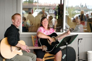 Photo by Jenny Neyman, Redoubt Reporter. Kent Peterson and Jeanne Duhan perform at Kaladi Brothers on Kobuk in Soldotna on Monday, the first of two weeks worth of free noon concerts around town as part of the Kenai Peninsula Orchestra Summer Music Festival.