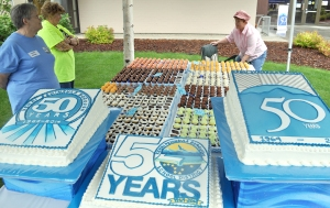 "In addition to a spread of barbecue food, there were more than 800 cupcakes and three 50th anniversary sheet cakes made by the Karen Otter, ""the Cake Lady,"" of Sterling, at the event."