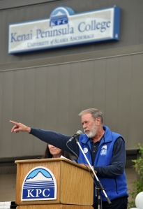 Photos by Joseph Robertia, Redoubt Reporter. Kenai Peninsula College Director Gary Turner points toward the new Career and Technical Center and the residence hall at KPC while talking about how far the education institution has come in the past 50 years during a golden-anniversary celebration for KPC, the Kenai Peninsula Borough and school district held Thursday at the college.