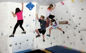 Students at Redoubt Rock Climbing, in Soldotna, practice their skills on a route across the three-dimensional wall that Nic and Natalie Larson built in their garage.