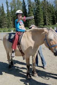 Part of the appeal of using horses in therapy is kids enjoy the sessions and are motivated to pay attention and follow instructions. Add games and fun props, such as this sword, and they're even more engaged.