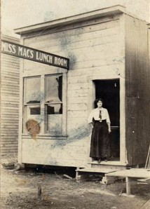 "Photo from the Betty Crocker collection. Jessie Parsons stands in the doorway of ""Miss Mac's Lunch Room"" in 1915, which was the start of Parsons Hotel in Anchorage."