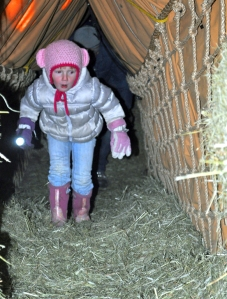 Photos by Joseph Robertia, Redoubt Reporter. Maci Miller uses a flashlight to cross one of the rope bridges inside Solid Rock Bible Camp's Hay Tunnel.