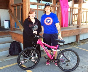Photo courtesy of Heidi Hanson. Heidi Hanson delivers a bike to Ashley Freeman in Homer in August.