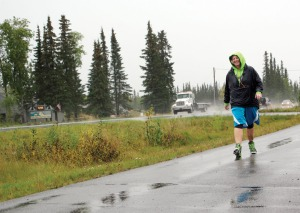 Photo by Jenny Neyman, Redoubt Reporter. Heidi Hanson walks in the rain along Kalifornsky Beach Road last month. Rain, snow, sleet, dark or any other conditions don't stop her from biking or walking daily.