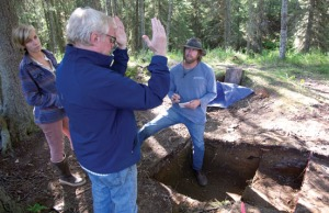 Photo by Jenny Neyman, Redoubt Reporter. Dr. Alan Boraas, anthropology professor at Kenai Peninsula College, discusses a Dena'ina house pit excavation with Dave Guilfoyle, an archaeologist with Applied Archaeology Australia, and assistant Genevieve Carey, near the Kenai Armory recently.