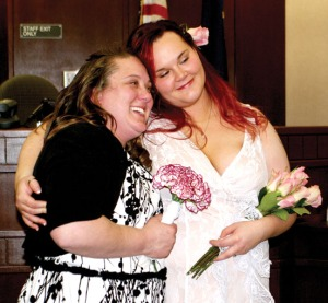 Photos by Jenny Neyman, Redoubt Reporter. Tanya Luck, left, and Heidi King were married Friday at the Kenai Courthouse after the lifting of the ban on same-sex marriages in Alaska. The couple has been together six years and had a commitment ceremony in 2010.