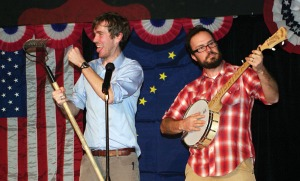 Bryan Lyke sings of his political aspirations as borough mayor candidate Carrol Martin, accompanied by and Dan Pascucci on banjo.