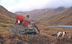 Photo by Calvin Fair, courtesy of Clark Fair . Troyer, Clark Fair (back to camera), Troyer's son Eric, and one of Troyer's early English setters rest after reaching Devil's Pass in the Chugach Mountains prior to hunting for ptarmigan in 1971.