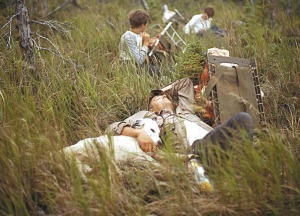 Photo by Calvin Fair, courtesy of Clark Fair. Will and one of his setters catch a nap during an exhausting moose-packing session in 1972.