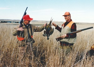 Photo courtesy of Janeice (Fair) Amick. Calvin Fair and Will Troyer display a pheasant they shot in a hunt in North Dakota in 1966.